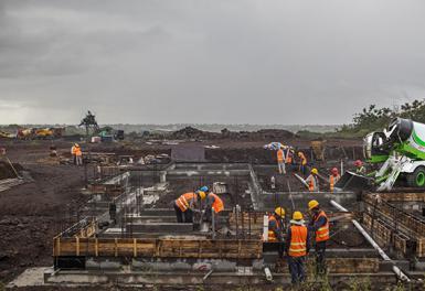 水泥自上料搅拌车土建工程施工
